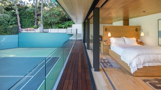 A contemporary guest house is located on the second floor of the tennis pavilion.