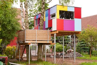 Known as St. Martin, this colorful tree house serves as a habitat and development center for children and adolescents with cognitive impairments. By collaborating with a garden architect, the team developed a spectrum of colors for the playful, patchwork-like facade.