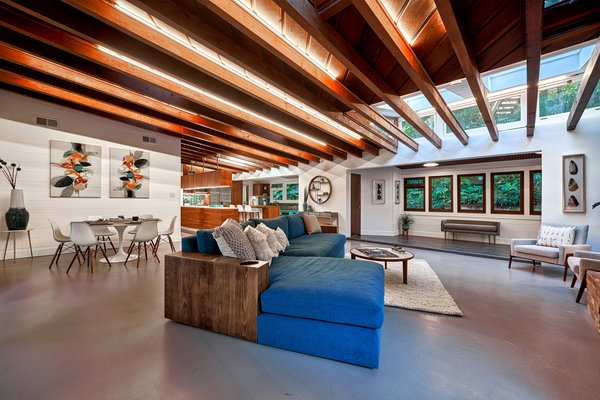 The home's main living space consists of a classic open floor plan, with beautiful exposed-beam ceilings.