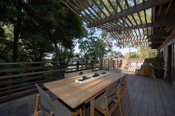 Perched above the lushly planted grounds, the 1,200-square-foot deck offers plenty of privacy along with sweeping vista views.
