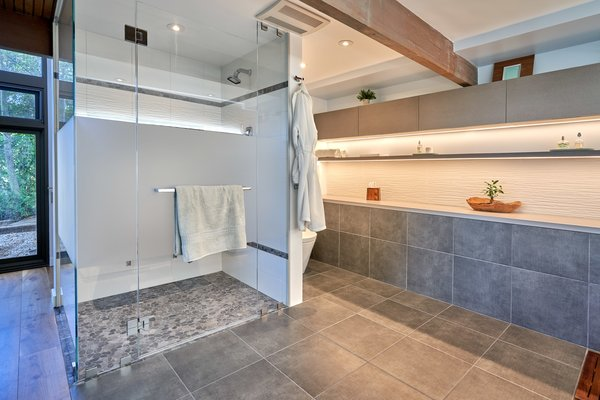 Exposed wooden beams continue into the master bath.