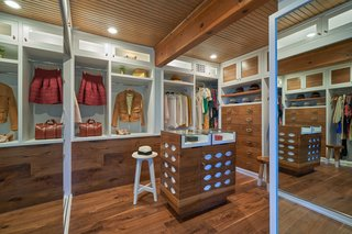 The master suite also includes a spacious walk-in closet with restored cabinetry.