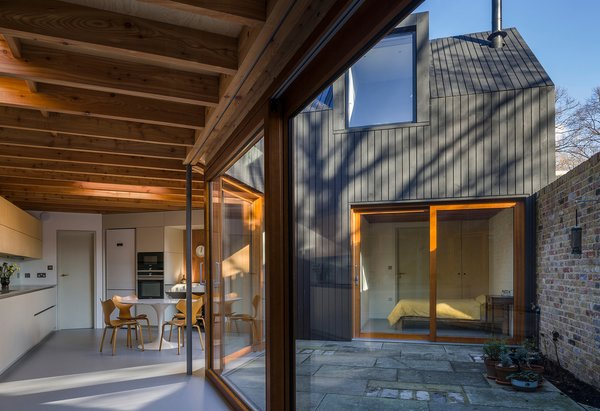 A courtyard connects a bedroom with the kitchen and dining area