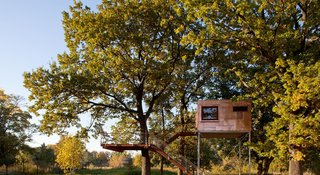 Located near Berlin, Germany, Copper Cube is a tree house with an integrated bathroom, minibar, and large bed.