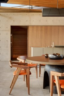 The kitchen features a warm, neutral color palette, similar to its dessert surroundings.