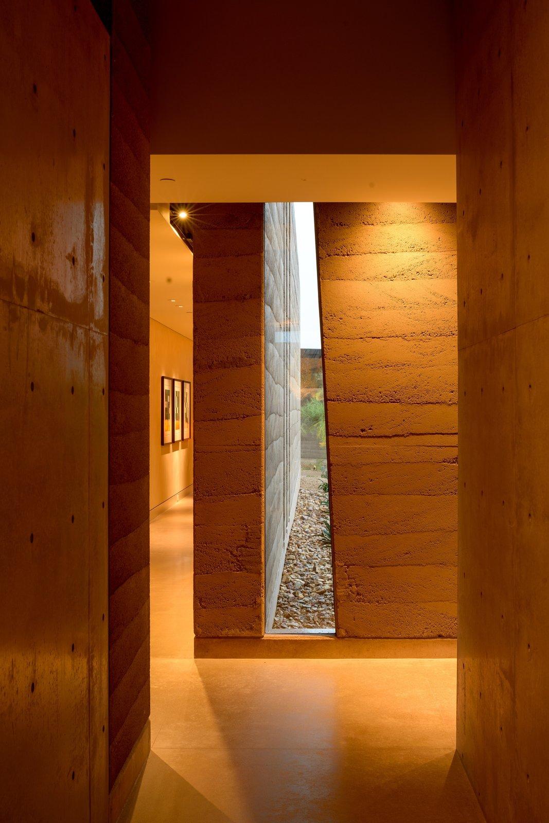 Dancing Light House rammed earth hallway