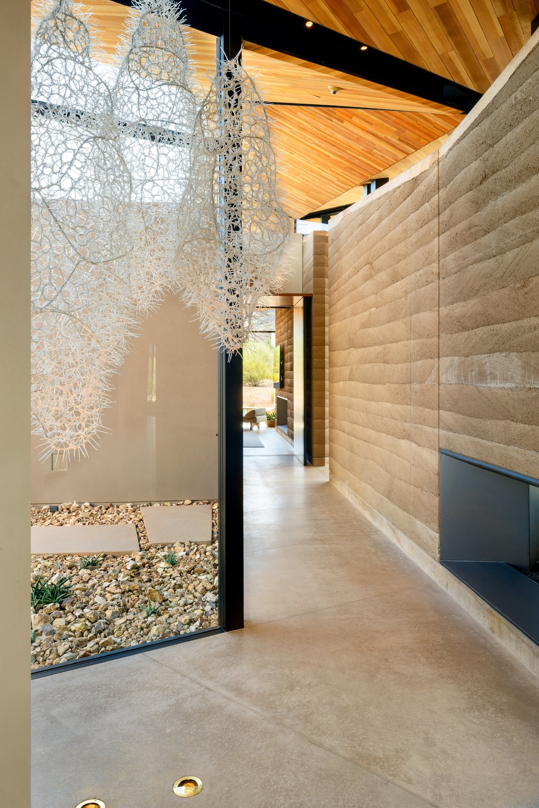 Dancing Light House rammed earth walls