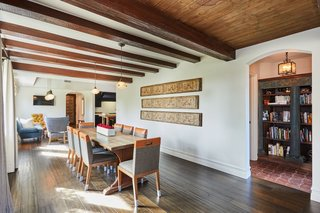 The natural wood beams and ceilings continue into the formal dining area.