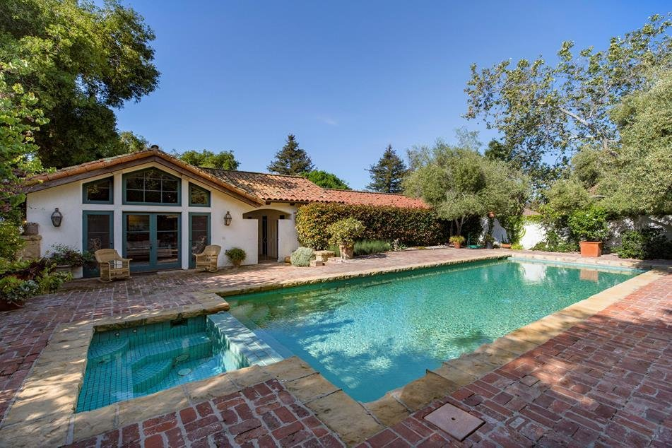 A pool and jacuzzi invite guests for a dip.  Photo 9 of 10 in Actor Jeff Bridges Lists His Spanish Colonial Revival Abode For $8M