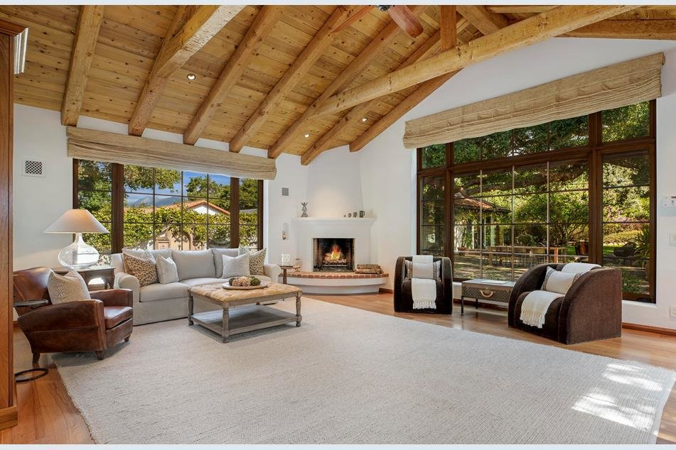 A second living area offers large picture windows and a corner fireplace in the Spanish style.  Photo 3 of 10 in Actor Jeff Bridges Lists His Spanish Colonial Revival Abode For $8M