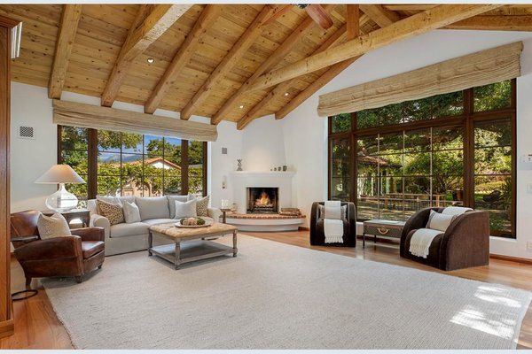 A second living area offers large picture windows and a corner fireplace in the Spanish style.