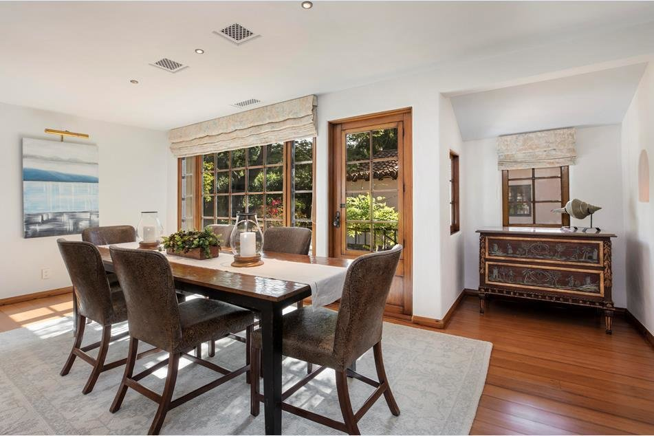 A formal dining room overlooks the backyard garden.  Photo 5 of 10 in Actor Jeff Bridges Lists His Spanish Colonial Revival Abode For $8M