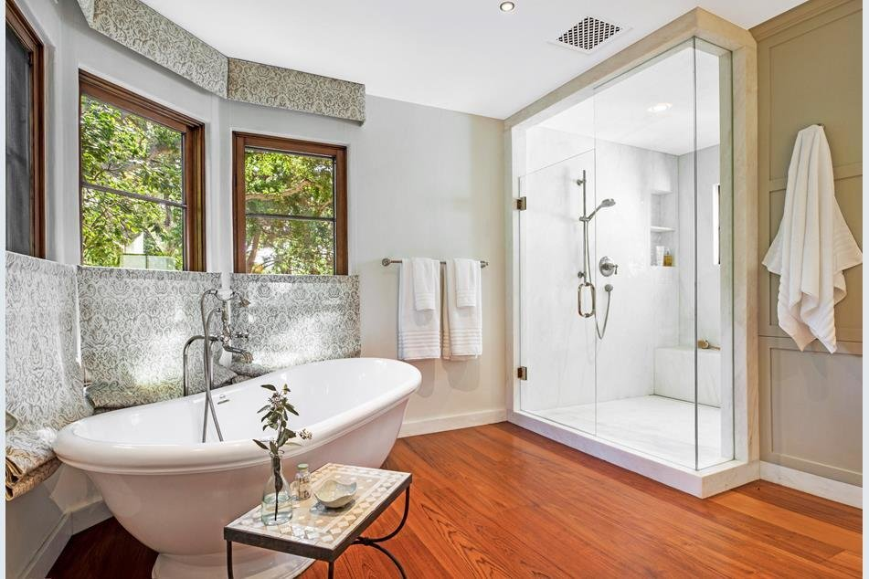 The modern master bathroom departs from the Spanish style to accommodate a large shower and soaking tub.  Photo 7 of 10 in Actor Jeff Bridges Lists His Spanish Colonial Revival Abode For $8M