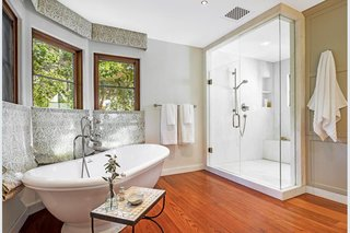 The modern master bathroom departs from the Spanish style to accommodate a large shower and soaking tub.