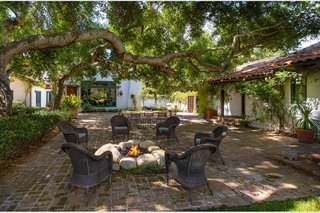 The brick patio provides a magical setting for outdoor dinners and entertaining.