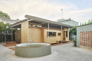Architect David Tapias Monné merged old and new at Josep Cruset and Encarna Rega's country house in Reus, Spain. Off the back of the original house, which Josep's family has owned for decades, Tapias created a 1,500-square-foot addition made of prefabricated cross-laminated timber (CLT). Existing features include a rainwater reservoir and a workshop once used by Josep's father.