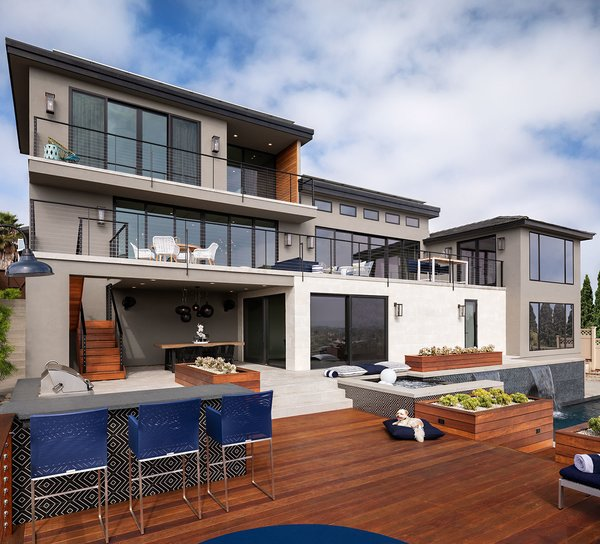 The multi-slide doors on the lower level connect the house to the pool with functional decks and terraces, achieving a modern look and reinforcing the indoor/outdoor lifestyle.