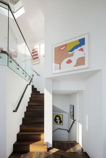 The spiraling floor plan of Robin and Fred Seegal's Sausalito home created a kaleidoscope of sightlines after architect Mark English removed most of the interior walls. Every vantage point highlights the owners' art collection, which includes screen prints from Andy Warhol's Campbell Soup series, Tom Wesselmann's 1965 Nude, and Deborah Kass's riffs on Warhol, 2012's Yellow Deb and 2000's Blue Deb.