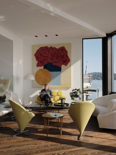 In the living room, Fred sits beneath Tom Wesselmann's Claire's Valentine Banner, from 1973. A George Nelson Yellow Marshmallow sofa from 1956 joins a Darrell Landrum coffee table, also from the 1950s, and a pair of Verner Panton Cone chairs.