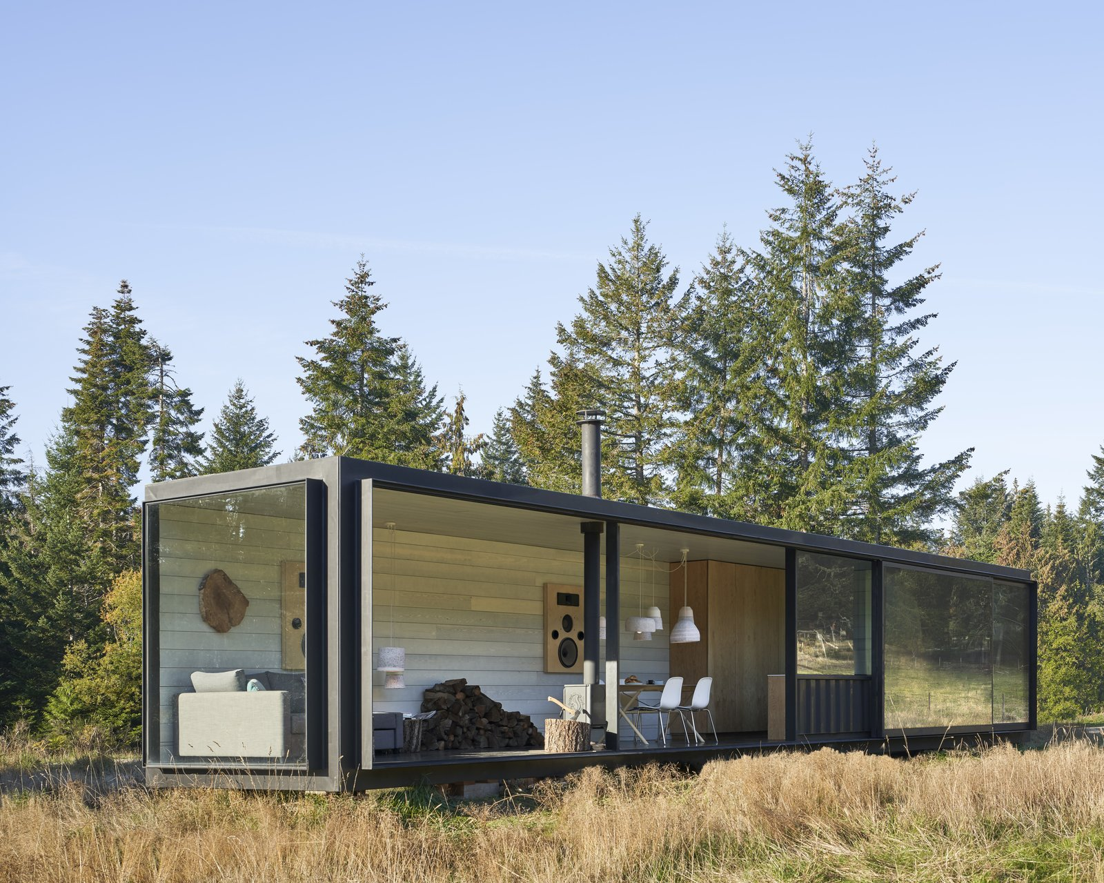 """""""It's the biggest one you can get,"""" says Patrick Powers of the shipping container he revamped and moved to Salt Spring Island, British Columbia. Steel frames hold ample glazing, including a pair of custom 2,000-pound sliding doors."""