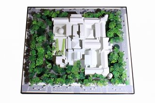 A model depicts the museum footprint within the surrounding park, both before and after construction of the new space.