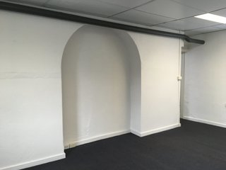 An original archway was repurposed for storage.