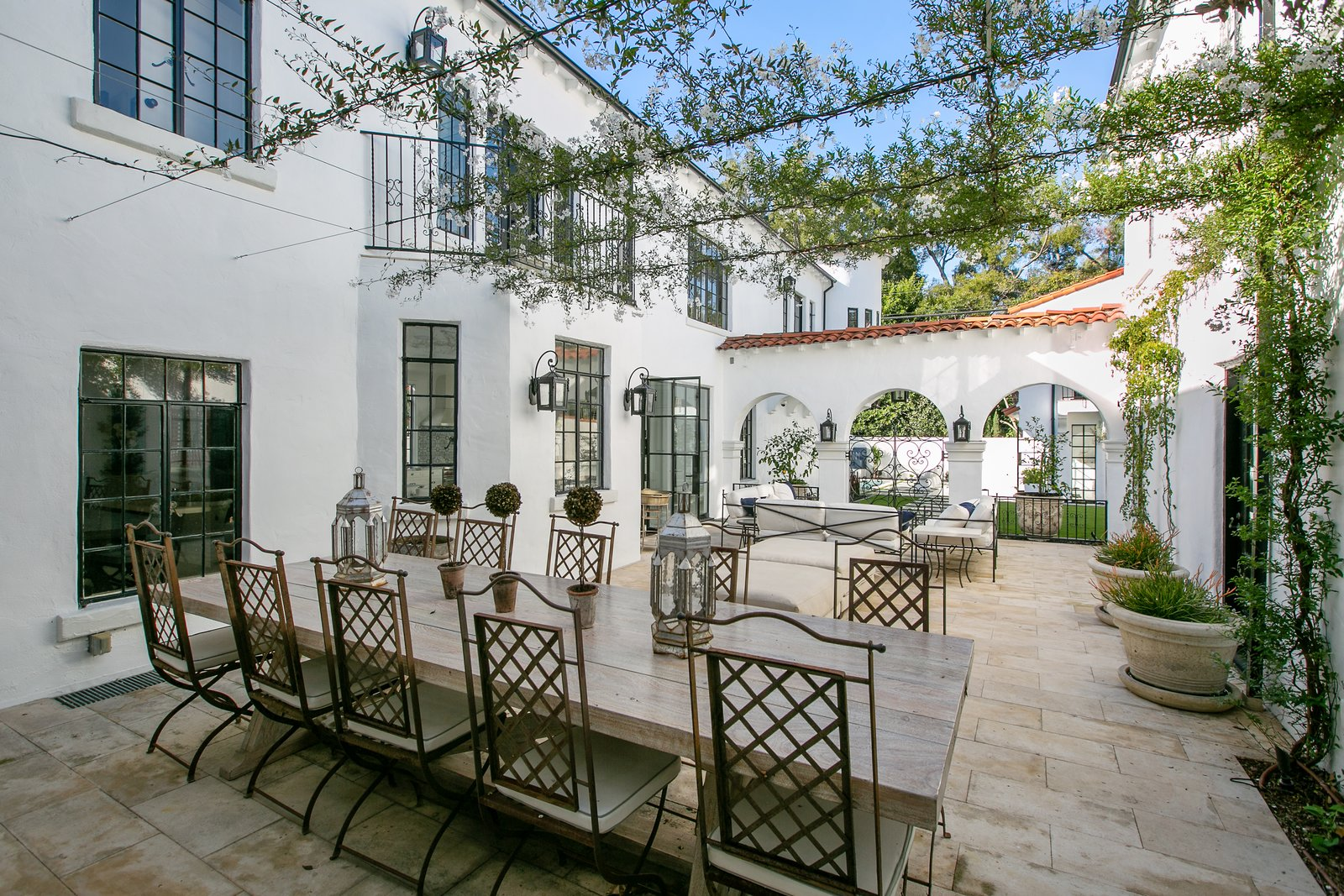 Outdoor, Stone, Large, Side Yard, Shrubs, Garden, and Tile All of the home's public spaces have access to the central courtyard, allowing a seamless flow for entertaining.  Outdoor Tile Side Yard Photos from Beck's Former Mediterranean-Style Retreat Lists For $8M
