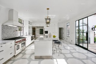 The bright and airy kitchen is comprised of Miele and Sub-Zero appliances.