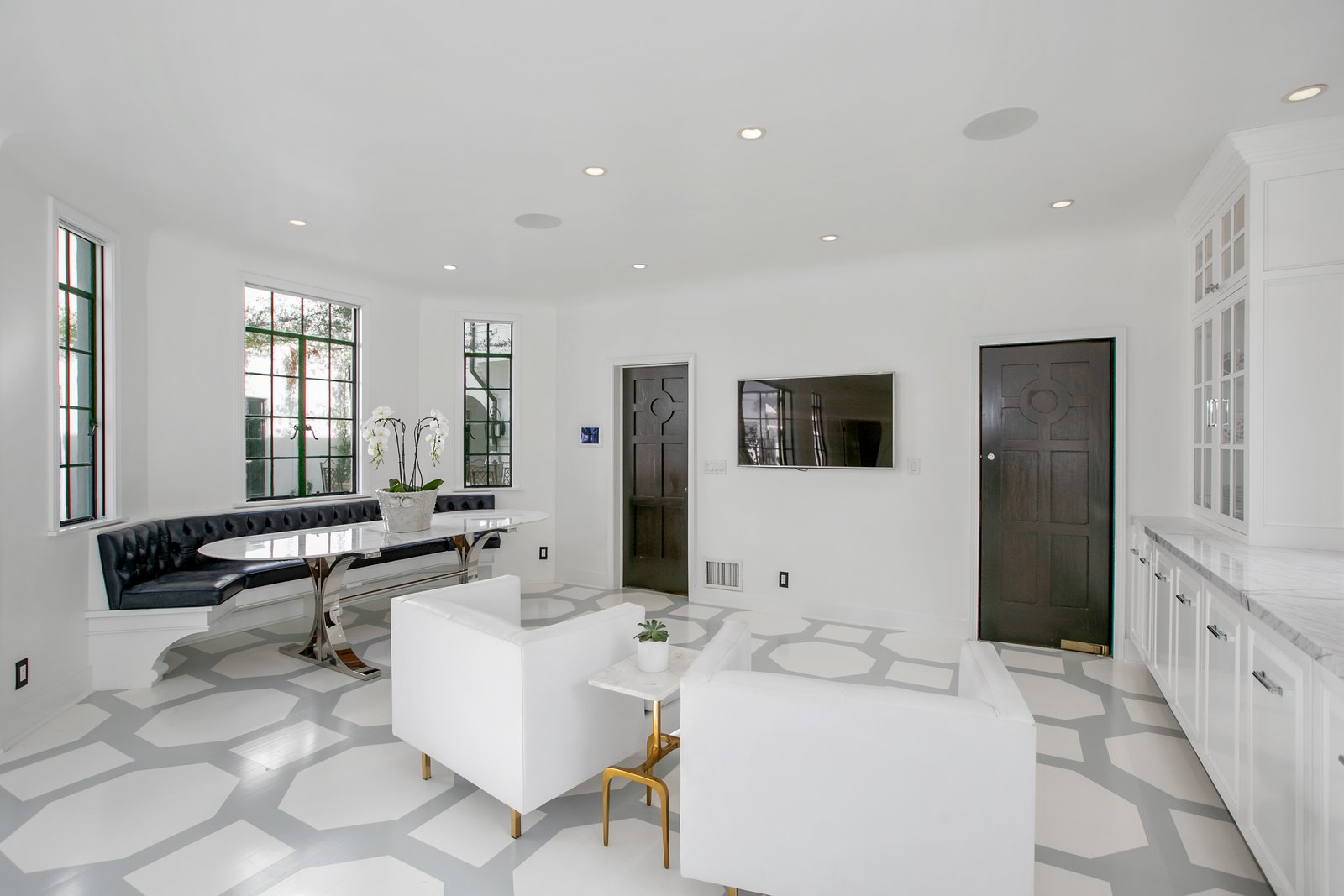 Dining Room, Bench, Vinyl Floor, Storage, and Recessed Lighting Along with a plush banquette, the whitewashed kitchen also has hand-painted floors.  Photo 7 of 14 in Beck's Former Mediterranean-Style Retreat Lists For $8M