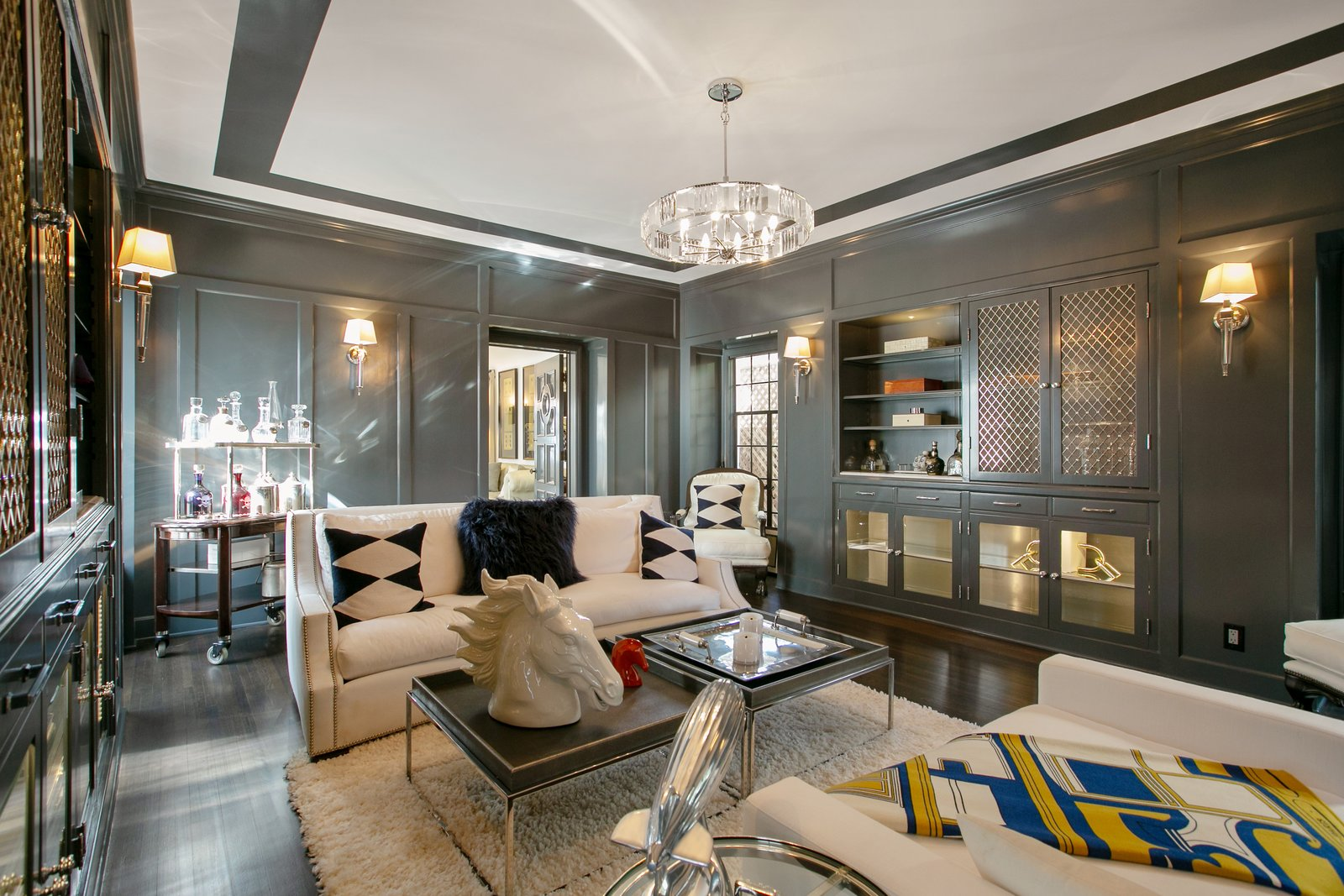 Office, Dark Hardwood, Chair, Bookcase, Library, Study, Shelves, Storage, and Rug The paneled library leads to another family room, wired for theatre sound.  Office Dark Hardwood Library Storage Photos from Beck's Former Mediterranean-Style Retreat Lists For $8M