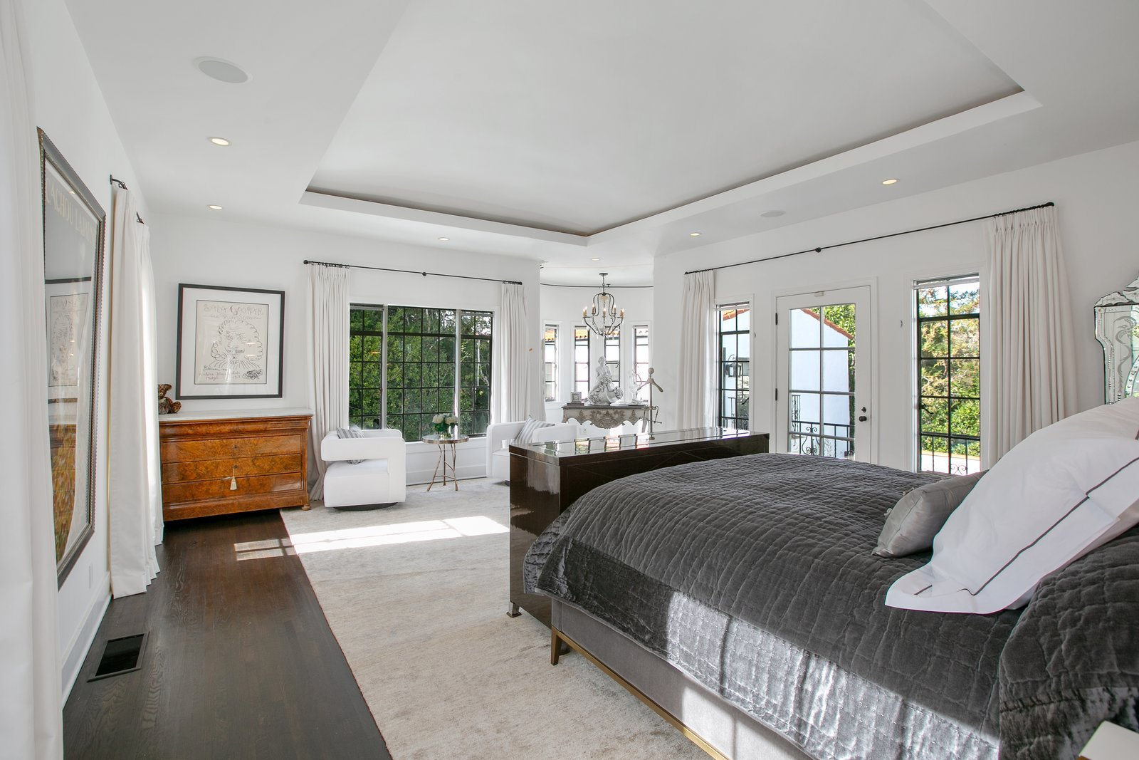 Bedroom, Dark Hardwood Floor, Night Stands, Dresser, Chair, Ceiling Lighting, Rug Floor, Recessed Lighting, and Bed In total, the home features six bedrooms, including a master suite which leads to a rounded writer's nook and private balcony.  Photos from Beck's Former Mediterranean-Style Retreat Lists For $8M