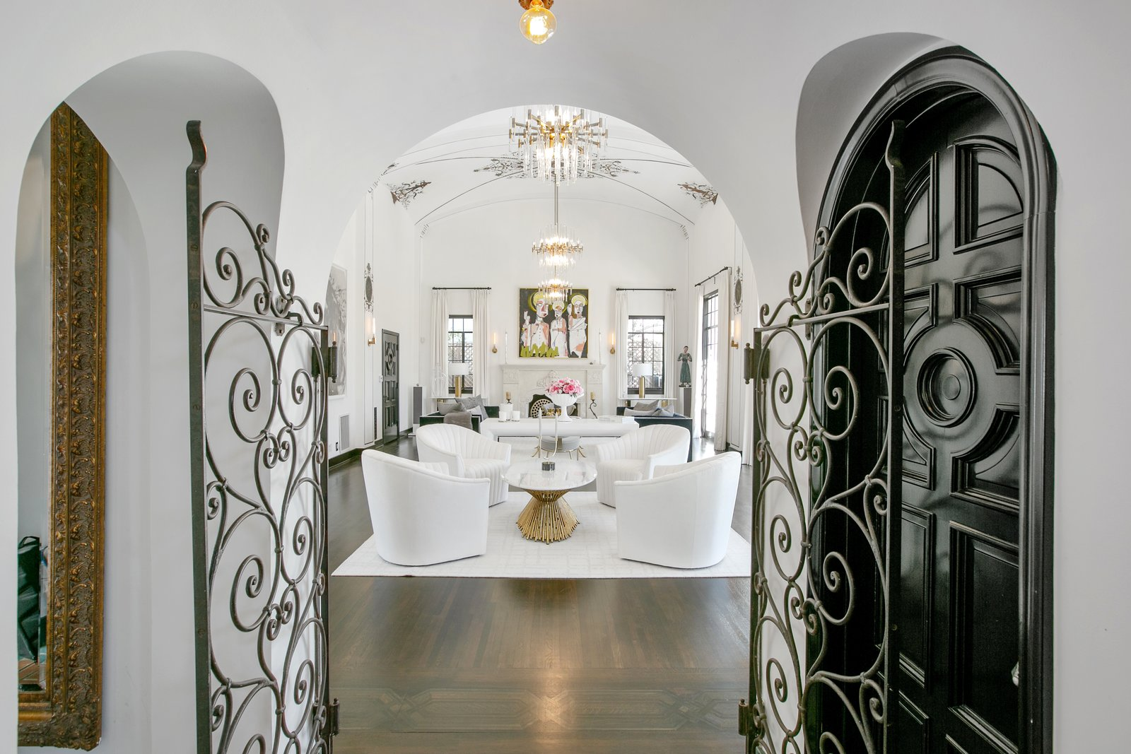 Living, Rug, Coffee Tables, Ceiling, Dark Hardwood, Chair, Standard Layout, Wall, and Sofa When entering the home, guests are led to the expansive living room through a turreted entry.  Best Living Standard Layout Wall Photos from Beck's Former Mediterranean-Style Retreat Lists For $8M