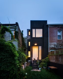 A rearview look at the slender yet highly functional residence.