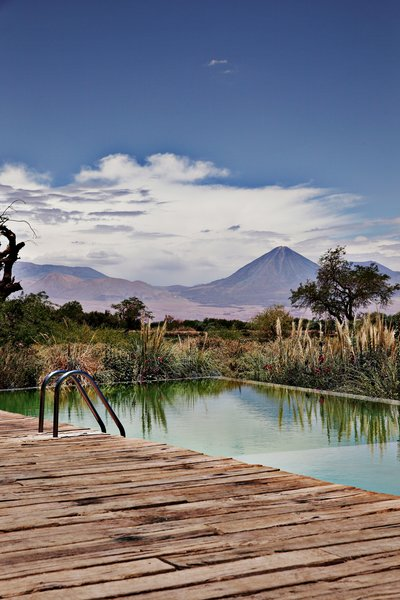 High in the northern desert of Chile, this eco-friendly boutique lodge is the ultimate location for stargazing and adventure trekking. The property features stunning views of Licancabur volcano.