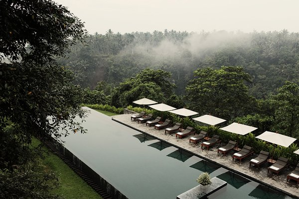 Designed as a hillside village, this secluded, modern retreat is located on the edge of the rich green Ayung River valley in Bali's central foothills.