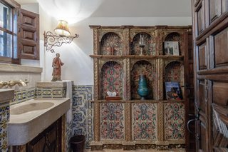 Each of the 10 bathrooms exudes unique charm, celebrating the area's traditional architecture.