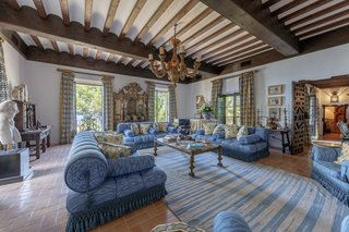 Restored wooden beams line the ceilings of several rooms throughout the home.