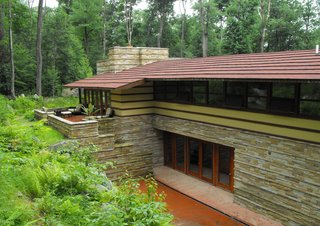 Built in 1957, this home was saved and dismantled at its original location in Illinois and relocated to its current location in Acme, Pennsylvania—only 30 minutes from the iconic Fallingwater. The Duncan House shares the 100-acre Polymath Park with three other homes for rent, designed by Wright's apprentices.