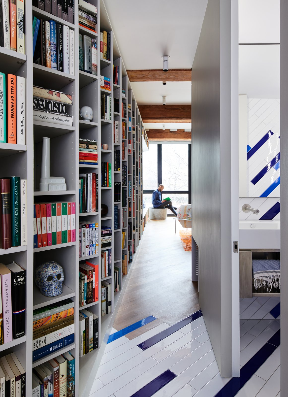 This Brooklyn Loft Keeps 2,500 Books Tidy With Angled Shelves