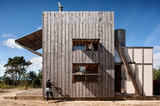 """""""A small volume at the rear is clad in contrasting 'flat sheet,' a cheap building material found in many traditional holiday homes,"""" explains the firm."""