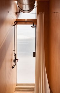 Fittings and mechanics are left exposed inside the home, enhancing its simplistic aesthetic.