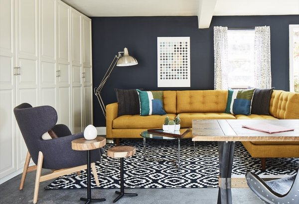 Apt2B's pieces feature colorful fabric upholstery options and quality wood accents.