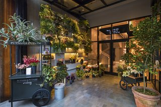 "Guests enter the hotel through the Putnam & Putnam Flower Shop, meant to be a ""botanical library"" of sorts with planter boxes climbing a 15-foot wall. It's the first retail space for owners Darroch and Michael Putnam, a couple whose clients include Gwyneth Paltrow and Bergdorf Goodman."