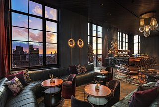 Located on the 35th floor, The Fleur Room is a raucous rooftop bar. Rich, textured details like a copper-clad bar, embossed leather seating, floral-patterned velvet, and a chandelier shaped like water droplets cement the hotel's florid, unabashed style. On the opposite side of the bar, guests take in views of the NYC skyline from a glass lounge with retractable wall, and a funky disco ball salvaged from 1980s L.A. nightclub Vertigo presides over a hip, art-school crowd.