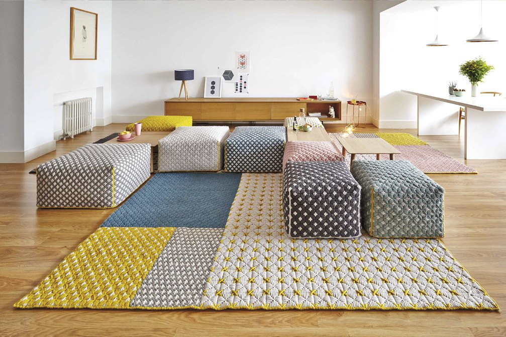 Living, Table, Chair, Console Tables, Medium Hardwood, Ottomans, Rug, Ceiling, Table, and Storage Bright pops of colored materials that are tufted and quilted are unique to GAN.  Living Storage Table Ottomans Photos from 7 Top Rug Makers Whose Designs We're Dying to Bring Home