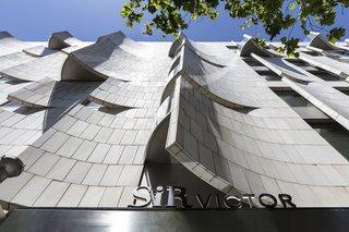 Capella Garcia designed the building's dynamic limestone facade in 2003.