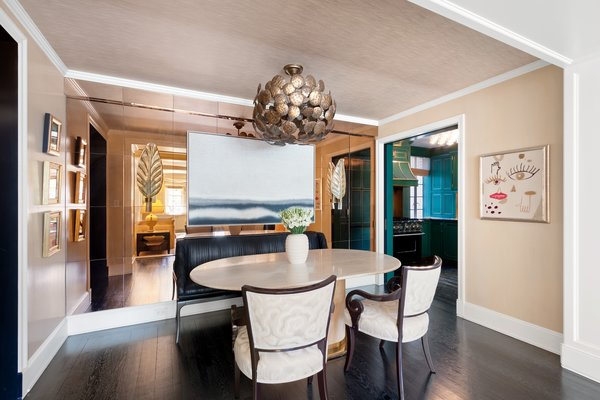 A rose-gold glass wall distinguishes the dining space from the living room.