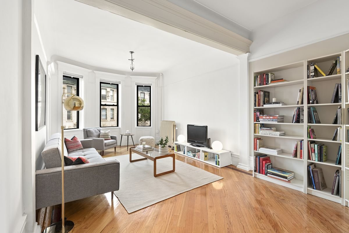 An abundance of natural light effortlessly brightens the home's spacious living room.