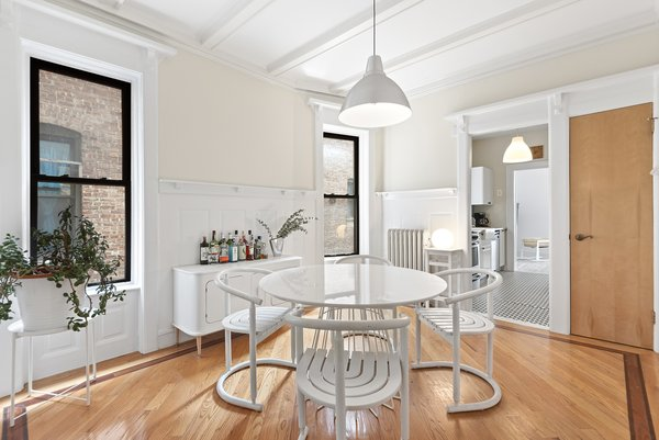Crisp, white molding in the dining room complements the richly textured hardwood floors.