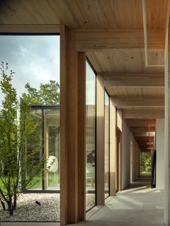 "To create a low-energy house, several passive environmental strategies have been incorporated into the home, including a heated floor system and exterior automated wood blinds. ""Natural air ventilation in every room and cross-ventilation between opposite facades keeps the need for air conditioning to a minimum,"